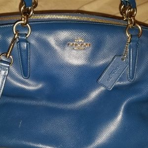 Cobalt Pebble leather coach with long strap